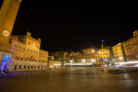 Night view of Campo Square (Piazza del Campo), Siena Palazzo Pubblico and Mangia Tower (Torre del Mangia) in Siena, Tuscany, Italy. Stock Photo