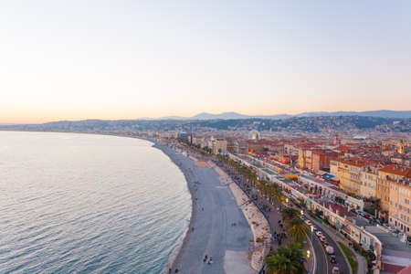 maritimes: Nice beach day landscape, France.  Nice beach and famous Walkway of the English, Promenade des Anglais. Famous French touristic town Stock Photo