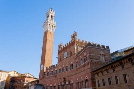 Day view of Campo Square (Piazza del Campo), Siena Palazzo Pubblico and Mangia Tower (Torre del Mangia) in Siena, Tuscany, Italy. Stock Photo