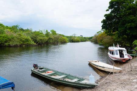 navigable: Houses along the Amazonas river. Brazilian wetland region. Navigable lagoon. South America landmark. Editorial