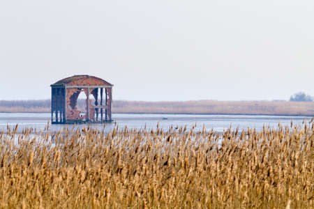 Old abandoned warehouse inside Po river lagoon. Italian panorama Stock Photo