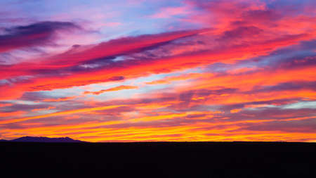 Sunset from Addo Elephant National Park, South Africa. Dramatic sky. Open space landscape Stock Photo