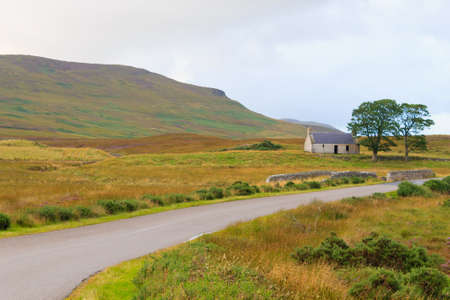 Scottish road trough countryside. Perspective road. Scotland panorama Stock Photo