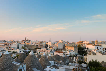 View of Alberobello with trulli roofs and terraces, Apulia region, Southern Italy. Famous Italian landmark. Typical village