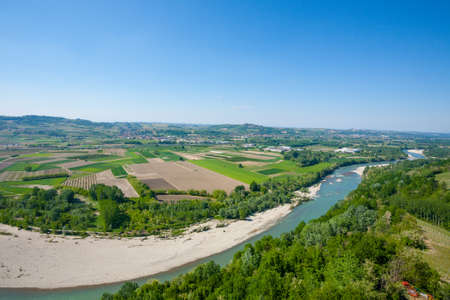Tanaro river view. Vineyards from Langhe region,Italy agriculture. Banco de Imagens