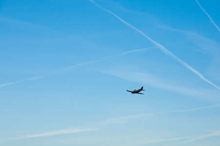 Airplane on blue sky. Transportation mode 写真素材