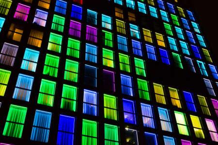 Colored windows texture.  Windows illuminated by neon lights background. Reklamní fotografie