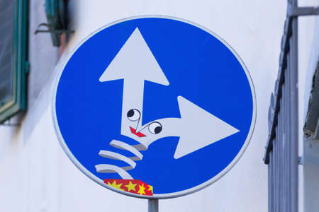 Road sign with funny box on the signal, street art, metropolitan art