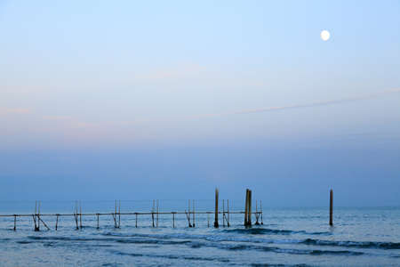 Beach landscape at dawn with moon. Jesolo beach view, Italian panorama Reklamní fotografie