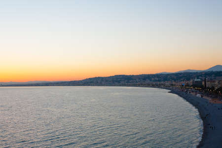 Nice beach day landscape, France.  Nice beach and famous Walkway of the English, Promenade des Anglais. Famous French touristic town Redakční