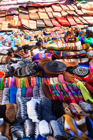 Tarabuco traditional market view, Bolivia. Colorful blankets background