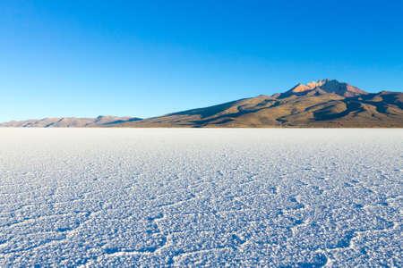 Salar de Uyuni, Bolivia. Largest salt flat in the world. Bolivian landscape. Cerro Tunupa view