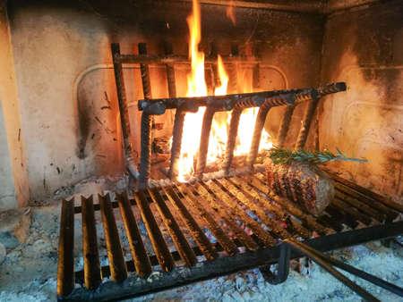 Grilled meat cooked on fireplace Reklamní fotografie