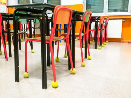 Classroom chairs in a row with tennis ball like bumpers Reklamní fotografie