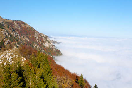 Panorama from Italian alps, carpet of clouds and peaks. Top mountain landscape Reklamní fotografie