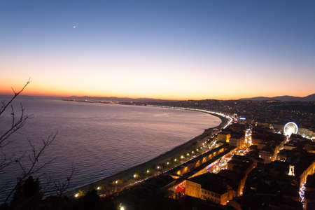 Nice beach night landscape, France.  Nice beach and famous Walkway of the English, Promenade des Anglais. Famous French touristic town Reklamní fotografie