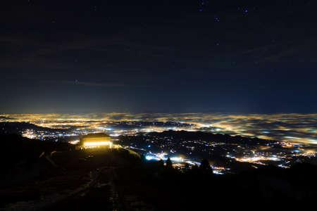 Plain illuminated partially covered by fog, soft lights.  Mount Grappa, Italian landscape Reklamní fotografie