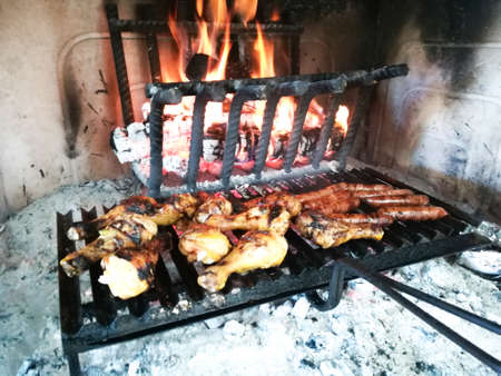 Grilled meat cooked on fireplace Foto de archivo