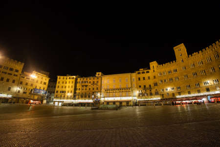 Night view of Campo Square (Piazza del Campo), Siena Palazzo Pubblico and Mangia Tower (Torre del Mangia) in Siena, Tuscany, Italy. Stok Fotoğraf