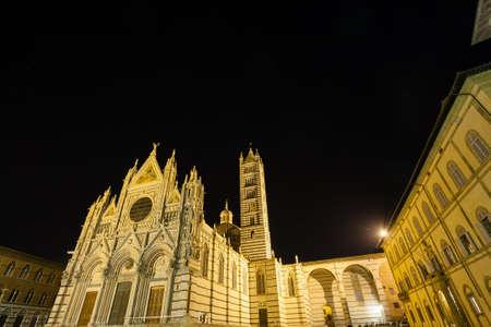 Night view of Siena Cathedral Santa Maria Assunta (Duomo di Siena) in Siena, Tuscany, italy.  Italian landmark Stock Photo