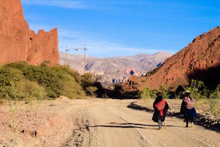 Bolivian people walking along dirt road,Bolivia. Bolivian landscape