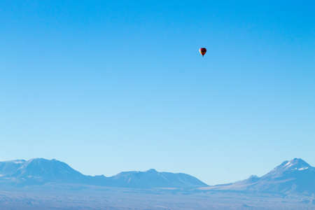 Hot air balloon over Chileand Andes. Minimal landscape