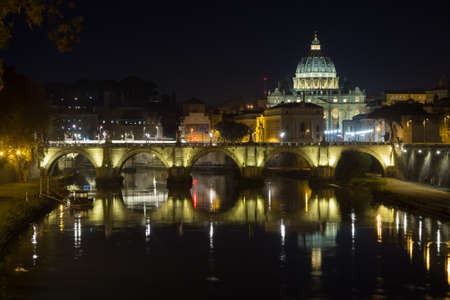 Night scene of Rome, Tevere river with Saint Peter basilica in background. Italian landmark Stok Fotoğraf