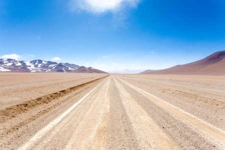 Bolivian dirt road perspective view,Bolivia. Salvador Dali Desert Stok Fotoğraf