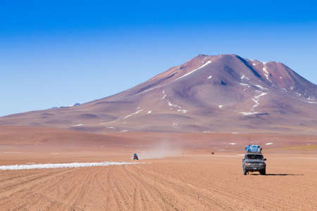 Off road vehicle on Bolivian andean plateau. Landscape from Bolivia.