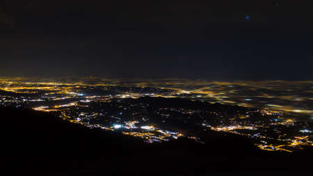 Plain illuminated partially covered by fog, soft lights.  Mount Grappa, Italian landscape Stockfoto