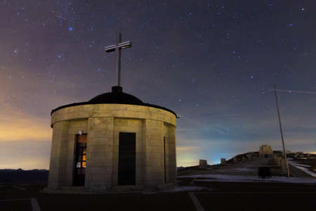 Monument with starry sky as a background. Mount Grappa war memorial view, Italian landmark.