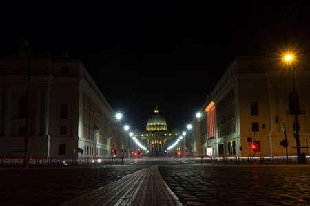 Night scene of Rome, perspective road with Saint Peter basilica in background. Italian landmark