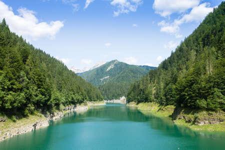 Val Noana artificial lake, Mezzano, Italy. Mountain landscape. Green water lake Stockfoto