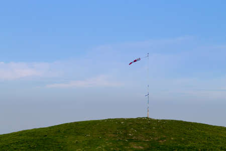 Isolated windsock on blue sky, sport background. Borso del Grappa paragliding site, Italy