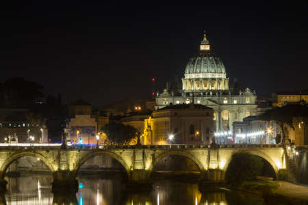 Night scene of Rome, Tevere river with Saint Peter basilica in background. Italian landmark Zdjęcie Seryjne