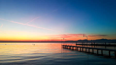 Sunset at Garda lake, Italy. Italian landscape. Pier in perspective Banque d'images
