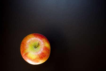 Apple on black table, food background. Isolated apple