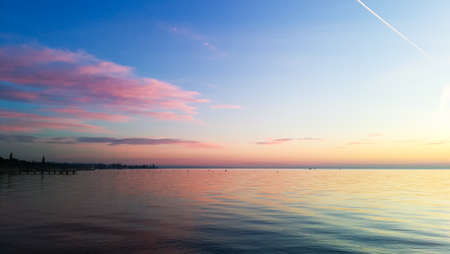 Sunset at Garda lake, Italy. Italian landscape. Pier in perspective Archivio Fotografico