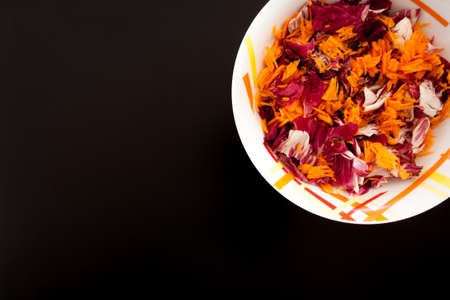 Salad with carrots on black table, top view. Food background Archivio Fotografico