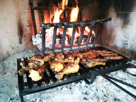 Grilled meat cooked on fireplace Archivio Fotografico