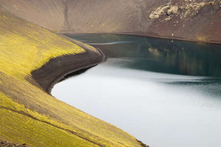 Volcanic crater with water near Landmannalaugar area, Iceland. Colored mountains Archivio Fotografico - 146790997