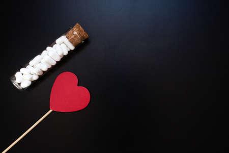 Jordan almonds and heart shape. Wedding decoration on black background