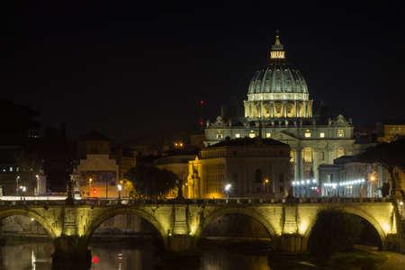 Night scene of Rome, Tevere river with Saint Peter basilica in background. Italian landmark Archivio Fotografico