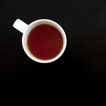 Cup of tea on black table, top view. Food background Archivio Fotografico - 147719206