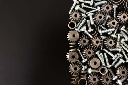 Background with mechanical components, gears, springs, screws, industrial objects