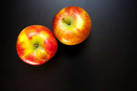 Apples on black table, food background. Isolated apples