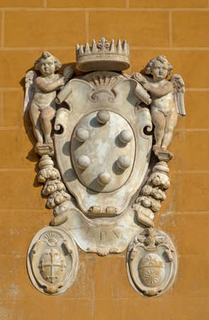 The Medici family embleme on a wall of Miracle