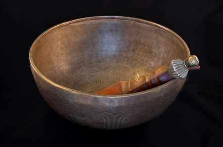 singing bowls: Bell used during buddhist prayers and also in alternative medicine