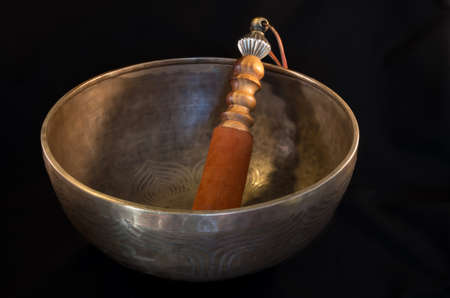 singing bowl massage: Bell used during buddhist prayers and also in alternative medicine