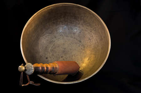 Bell used during buddhist prayers and also in alternative medicine photo